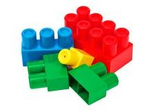 Stuk speelgoed die kleurrijke blokken bouwen Stock Afbeeldingen