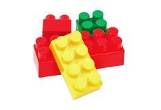 Stuk speelgoed die kleurrijke blokken bouwen Stock Fotografie