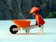 Stuk speelgoed Gardner met kruiwagen royalty-vrije stock afbeelding