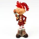 Stuk speelgoed het meisjes` s cijfer met bloem dichte omhooggaand royalty-vrije stock fotografie