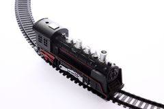 Stuk speelgoed locomotief op sporen royalty-vrije stock afbeelding
