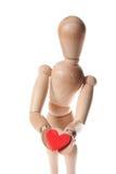 Stuk speelgoed met in hand hart Stock Afbeelding
