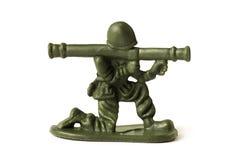 Stuk speelgoed militair, op witte achtergrond wordt geïsoleerd die Stock Foto