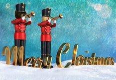 Stuk speelgoed militairen die in rode eenvormige het spelen trompetten christma aankondigen royalty-vrije illustratie