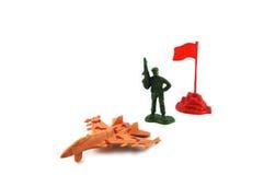 Stuk speelgoed één militair en militaire basis Royalty-vrije Stock Foto