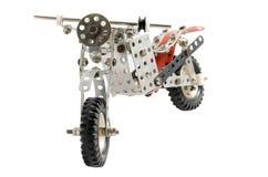 Stuk speelgoed oude uitstekende die motor op witte achtergrond wordt geïsoleerd Stock Foto