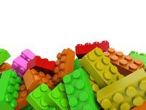 Stuk speelgoed plastic bakstenenachtergrond in warme kleuren Royalty-vrije Stock Foto's