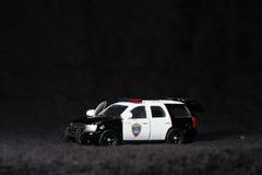 Stuk speelgoed politiewagen Royalty-vrije Stock Fotografie