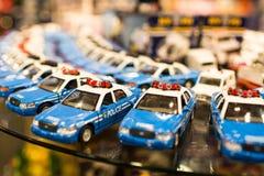 Stuk speelgoed politiewagens Stock Afbeelding