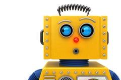 Stuk speelgoed robot die aan de linkerzijde kijken Stock Fotografie