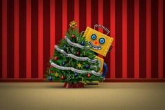 Stuk speelgoed robot gelukkig met Kerstmisboom Stock Foto's