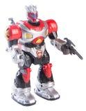Stuk speelgoed robot op een achtergrond Stock Foto's