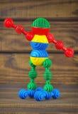 Stuk speelgoed robot van stuk speelgoed plastic kleurrijke details wordt gemaakt dat Stock Foto's