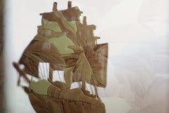 Stuk speelgoed schip dubbele blootstelling Stock Afbeelding