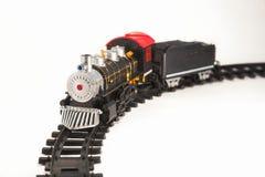 Stuk speelgoed stoomlocomotief op sporen Stock Foto