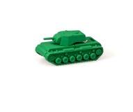 Stuk speelgoed tank op een witte achtergrond wordt geïsoleerd die stock foto
