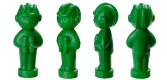 Stuk speelgoed tankmen de plastic militairen met in een helm en met geïsoleerde verrekijkers stock afbeeldingen