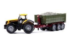 Stuk speelgoed tractor met oplegger Stock Foto's