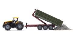 Stuk speelgoed tractor met oplegger Stock Foto