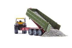 Stuk speelgoed tractor met oplegger Royalty-vrije Stock Afbeelding