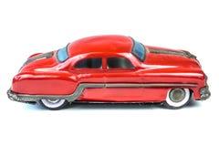 Stuk speelgoed van de jaren '50 het uitstekende rode die auto op wit wordt geïsoleerd Stock Fotografie