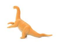 Stuk speelgoed van zijaanzicht het oranje diplodocus royalty-vrije stock fotografie