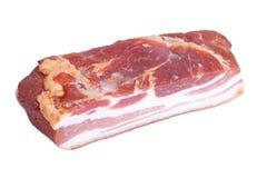 Stuk van bacon op een witte achtergrond wordt geïsoleerd die royalty-vrije stock foto's