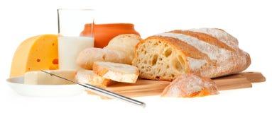 Stuk van boter, brood en een mes royalty-vrije stock foto's