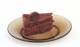Stuk van cake op een donkere schotel Stock Fotografie