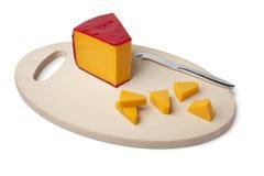 Stuk van de kaas van de Cheddar stock afbeeldingen