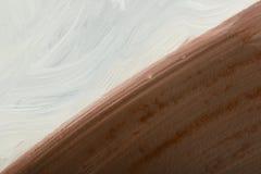 Stuk van een gekwetst beeld met diagonaal gevestigde witte en bruine kleuren Royalty-vrije Stock Fotografie