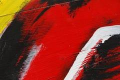 Stuk van geschilderde metaalmuur met zwarte, rood, geel en whit Stock Afbeelding
