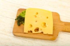 Stuk van kaas stock afbeeldingen