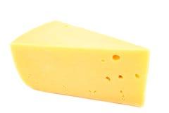 Stuk van kaas op een witte achtergrond stock afbeeldingen