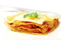 Stuk van lasagna Stock Afbeeldingen
