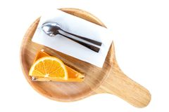 Stuk van oranje cake op houten raad royalty-vrije stock foto