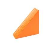 Stuk van oranje houten stuk speelgoed blok op wit stock afbeeldingen