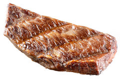 Stuk van vlees op wit wordt geïsoleerd dat. Geroosterd Rundvleeslapje vlees. stock foto