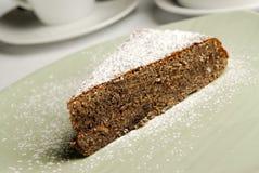 Stuk van zoete cake met suiker Stock Afbeeldingen