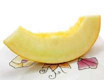 Stuk van zoete honingsmeloen op een wit stock fotografie