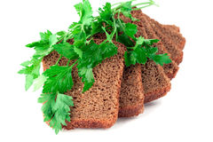 Stukken van brood met peterselie stock foto