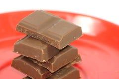 Stukken van chocolade op plaat Stock Foto