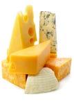 Stukken van kaas Stock Afbeeldingen