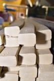 Stukken van zeep op een transportband Stock Afbeelding