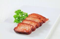 Stukken van zout varkensvlees Stock Afbeeldingen
