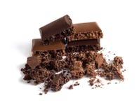 Stukken van zwarte en chocolade poreuze chocolade Royalty-vrije Stock Foto