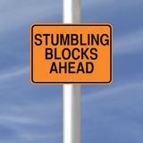 Stumbling Blocks Ahead. A road sign warning of stumbling blocks ahead Stock Photo