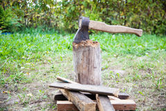 Stump with an ax and firewood Stock Photography