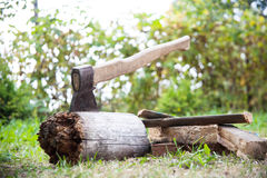 Stump with an ax and firewood Stock Photos
