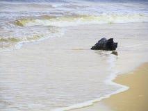 Stump on the  beach , Sri -Lanka. Wave  on the sand beach with stump background , Sri-Lanka Stock Images